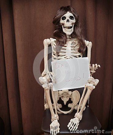 skeleton-wig-sitting-chair-holding-paper-written-message-against-dark-brown-background-45667823